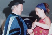 Frida Berrigan receiving her diploma at the 1996 Hampshire College graduation ceremony.