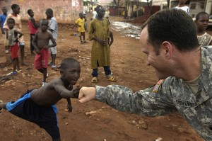 U.S. Army Lt. Col David Sigmund greets a young boy after passing out soccer balls to local children during exercise Flintlock 2007 in Bamako, Mali, Sept. 4, 2007. (Flickr/Tech. Sgt. Roy Santana)