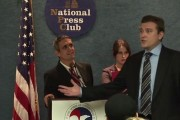 Andy Bichlbaum of the Yes Men (left) poses as U.S. Chamber of Commerce representative much to the chagrin of the real Chamber representative. (Vimeo / The Yes Men)