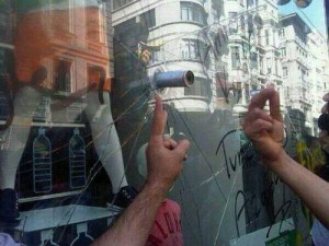 "@russian_market: ""In Beyoglu - Taksim, a tear gas bullet goes through a shop window. So what was Turkish police exactly doing?"" (Twitter/russian_market)"