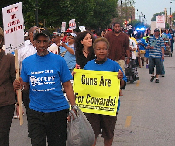 Community members march on the south side of Chicago on June 21 to challenge the gun violence that has ravaged the city. (WNV/Ken Butigan)