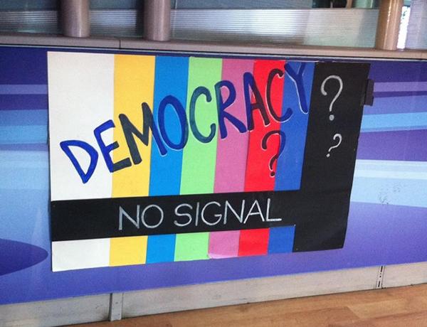 A protest banner displayed at ERT's reception desk. (WNV/Kirsten Han)