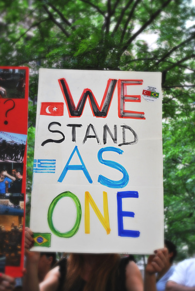 Sign held by demonstrator in Zuccotti Park on June 22. (WNV/Peter Rugh)