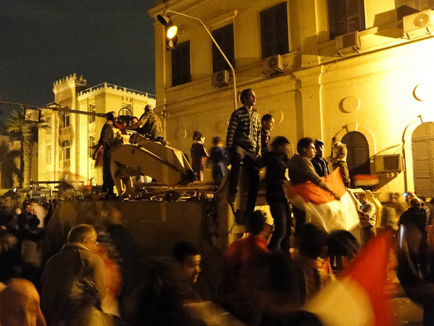 Egyptian protesters climb army tanks to celebrate the fall of President Hosni Mubarak on February 11, 2011. (Flickr/Ramy Raoof)