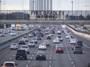 A banner hung over Interstate 580 in Oakland, Calif. (Flickr/Bradley Manning Support Network)