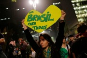 """A woman holds up a heart-shaped sign that reads in Portuguese """"One Brazil for all,"""" on Paulista Avenue where crowds gathered to celebrate the reversal of a fare hike on public transportation, in Sao Paulo, Brazil, Thursday, June 20, 2013. (Flickr/Sebástian Freire)"""