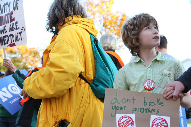 A child holds a sign at the November 6, 2011, Tar Sands Action rally around the White House in Washington, D.C. (Flickr/Christine Irvine)