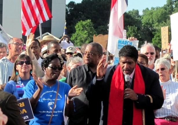Rev. Dr. William Barber speaking at a Moral Monday rally on July 15. (Flickr/twbuckner)