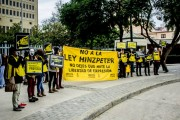 A protest by Amnesty International, Greenpeace and Accion outside of Chile's Congress to revoke the Hinzpeter law on August 6. (WNV/Gabriela Penela)
