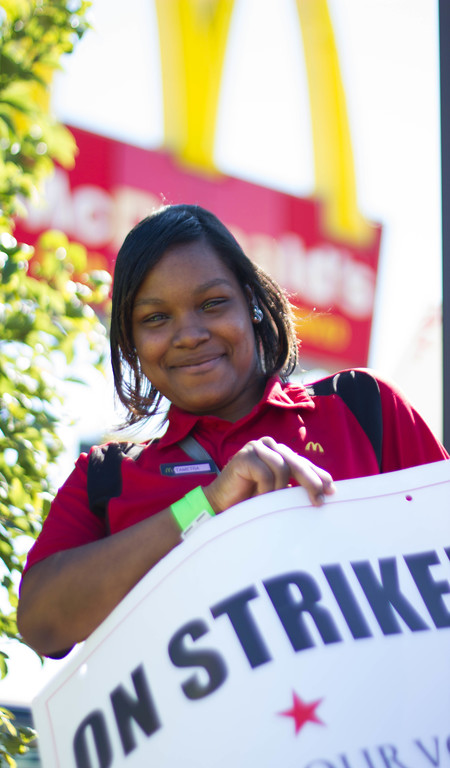Tametra Cloyd was waiting for her bus to go to work when she decided to join the Raise Up MKE campaign in Milwaukee, Wis. (Left in Focus/Bryan MacCormack)