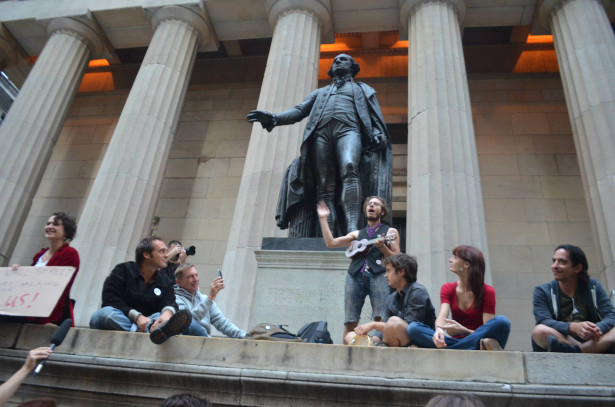Occupy Wall Street activists at the steps of the Federal Hall Memorial on Wall Street at Sunday's OWS Participatory Walking Tour. (Stacy Lanyon)