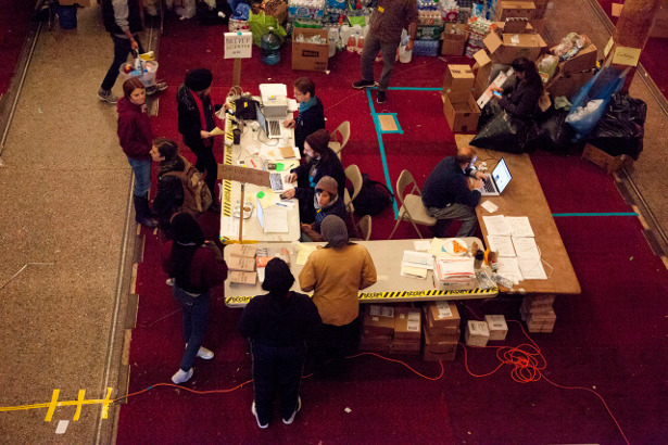 Occupy Sandy volunteers organize relief efforts at a church in Brooklyn. (sandyvolunteer/Erin Patrice O'Brien)