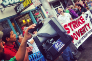 Striking Subway worker addresses march in Seattle. (WNV/Joshua Stephens)