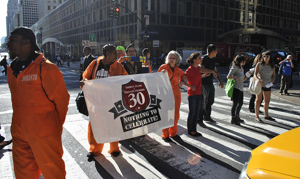 Protesters disrupt a Corrections Corporation of America investors' meeting in Midtown Manhattan. (Flickr/VOCAL-NY)