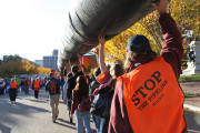 Keystone XL protesters carry a replica pipeline during a massive demonstration on November 6, 2011. (Flickr / Tar Sands Action / Christine Irvine)