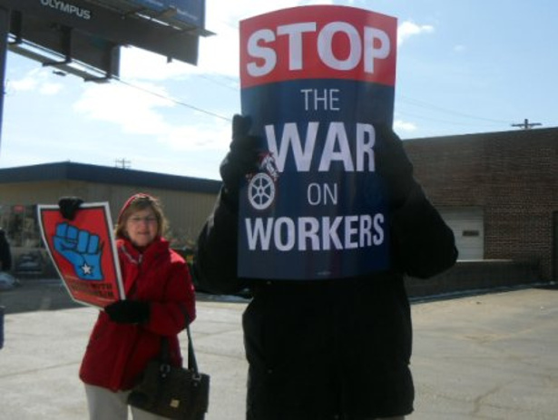Protest signs at a labor rally in Wisconsin in 2011. (Flickr/Rochelle Hartman)
