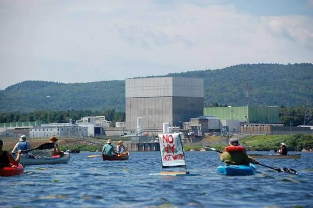 Paddlers near the Vermont Yankee power plant in August. (Facebook/Shut Down Vermont Yankee)