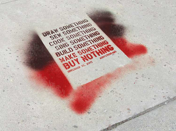 An Adbusters quote spray painted onto a sidewalk. (Flickr / resa & krister)
