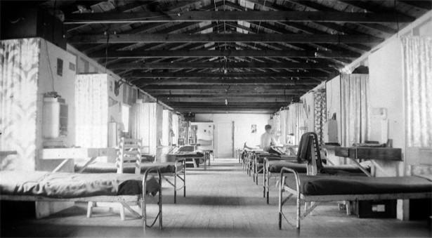 Interior of Civilian Public Service dormitory at Camp Snowline (CPS #31), near Camino California, 1945. (Wikimedia/Leo Harder)