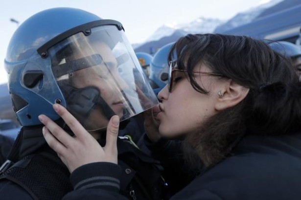 Nina De Chiffre kisses a police officer at a recent protest in Italy. (AFP/Getty/Mark Bertorello)