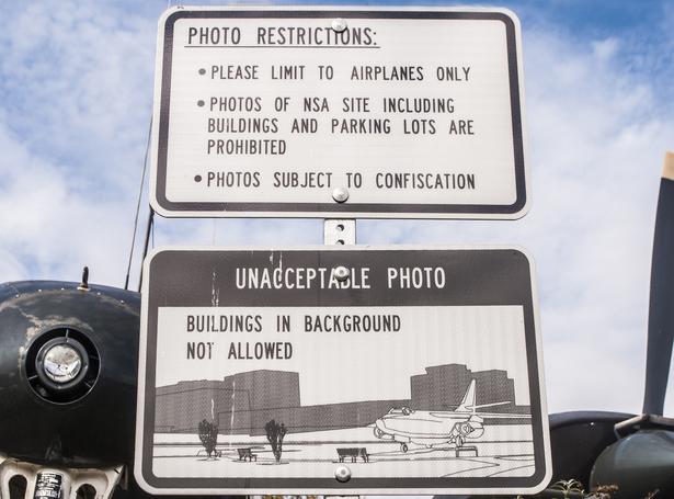In a small park next to the National Security Agency in Fort Meade, Maryland, signs explain rules about photographs one can take—and illustrate the kind of photo one isn't allowed to take. (WNV/Ingrid Burrington)