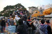 Protesters seize a bulldozer in an attempt to plow through police barricades outside Government House last month. (WNV/Mark Fenn)