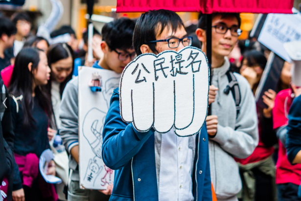 "A protester on Hong Kong with a sign that reads ""Citizens Nominate."" (Flickr/Leung Ching Yau Alex)"