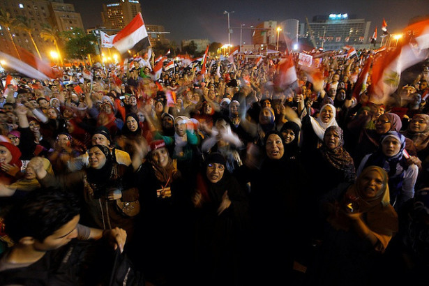 Egyptian protesters shout slogans against Egyptian President Mohammed Morsi as they watch his speech at Tahrir Square, the focal point of Egyptian uprising, in Cairo, Egypt, Wednesday, June 26, 2013. (Flickr/AP Photo/Amr Nabil)