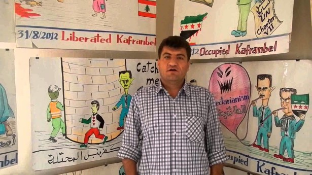 Raed Fares heads the Kafranbel Media Center, creators of Syria's witty demonstration banners. (YouTube / Shadi Latta)