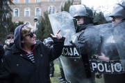 Protesters argue with police in Sarajevo on February 8, 2014, outside the city's municipal building. It sustained heavy damage after protesters attacked and set fire to it. (WNV/Jodi Hilton)