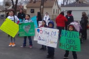 "Children hold signs at the ""Coming Out of the Shadows"" event in Melrose Park, Il., on March 22. (WNV/Andreina Cruz)"