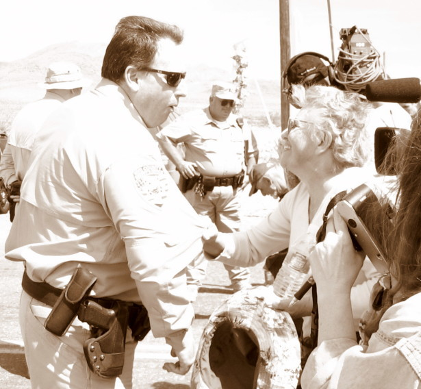 Sr. Klaryta tries coaxing one of the Sheriff's deputies across the line at the Nevada Test Site, April 2007. (WNV/Mario P. Intino, Jr.)