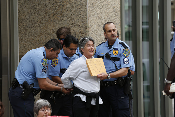 A #NOKXL activist is arrested during a sit-in outside TransCanada offices in Houston, Texas in 2013. (Flickr / Aaron M. Sprecher)