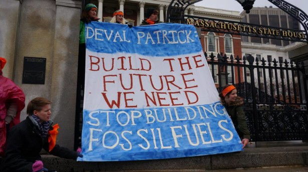 Youth climate activists hold a sign outside the Massachusetts Statehouse in Boston on Monday. (SJSF)