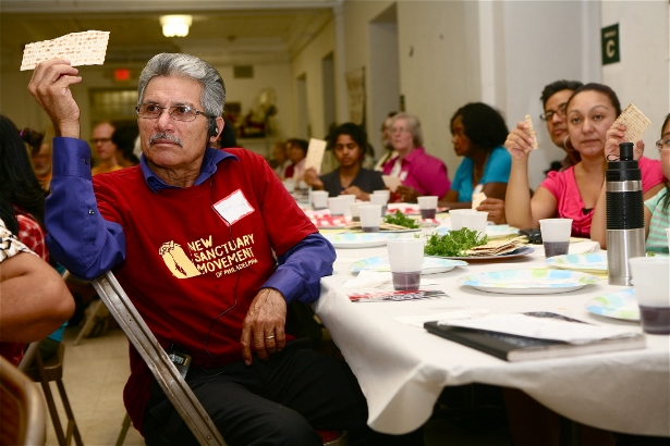 Over 125 people and 13 faith communities fasted with NSM during the 40 Days of Action, Fasting, and Prayer for immigrant justice campaign during the summer 2013. At the break the fast meal, Rabbi Linda Holtzman lead 200 people in a Passover ritual.  (WNV/Harvey Finkle)