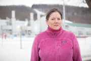 Fracking-foe Helen Slottje standing in front of a natural gas compression facility in Ithica, NY. (Goldman Environmental Prize)