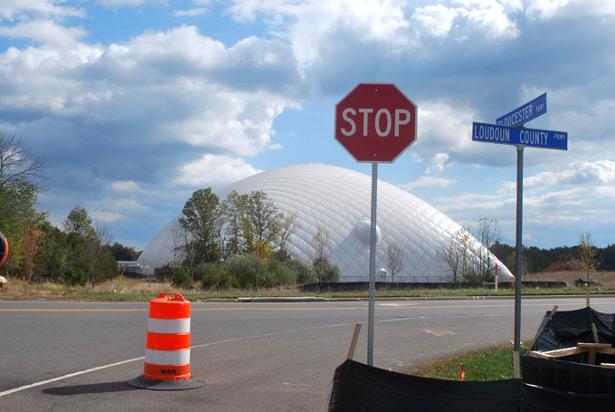 View of Washington Redskins training camp across from a data center construction site in Ashburn, Va. (WNV/Ingrid Burrington)