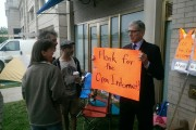 FCC Chair Tom Wheeler holding a sign when he came out to meet activists at the Occupy the FCC encampment. His proposed open internet rules, however, would not sufficiently safeguard net neutrality. (Fight for the Future)