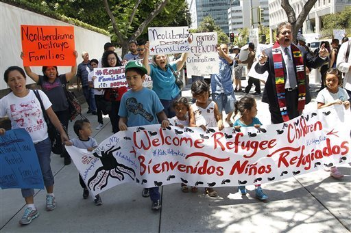 Activists are demanding refugee status for Central American immigrants (Calling out the root causes of the violence that drives immigrants to the U.S. , activists are demanding Central American children be treated as refugees. (Rebecca Blackwell/AP)