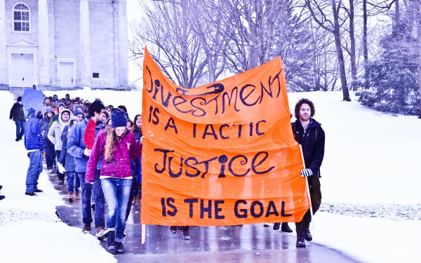 On March 4. over 125 Middlebury College students march to persuade the administration to divest from fossil fuels and gun manufacturers, despite the wind and snow. (Paul Gerard/Middlebury Campus)