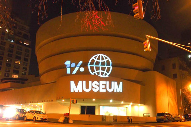 The Illuminator projection team casts light on the Guggenheim Museum in New York City as part of a GULF protest. (GULF/Nitasha Dhillon)