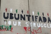 The Xhosa concept of ubuntu, combined with the Arabic word intifada — as seen in this graffiti on the separation wall in Bethlehem — roughly translates to mean uplifting human dignity through nonviolence. (WNV / Van Hook)