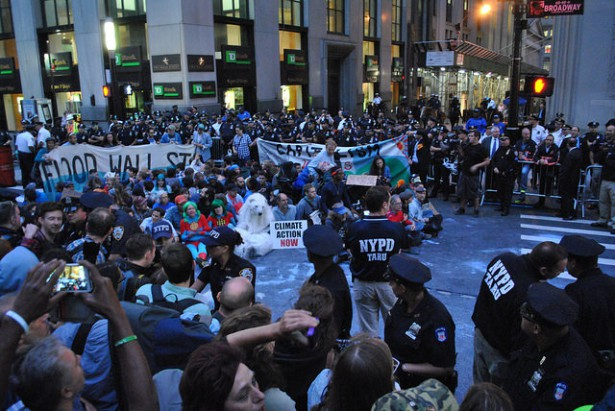 Flood Wall Street protesters ignore police warnings and wait to be arrested. (WNV / Peter Rugh)