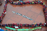 Protesters gathered in Portland's Pioneer Courthouse Square to call on Governor Kitzhaber to oppose coal exports in Oregon and the Pacific Northwest in March. (Power Past Coal / Alex Milan Tracy)