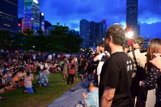 Benny Tai, co-founder of Occupy Central, gazes at the crowd assembled outside the Central Government Complex after Beijing's ruling was announced on August 31. (WNV / Elaine Yu)