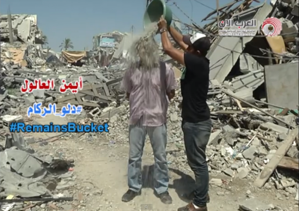 Palestinian journalist Ayman al-Aloul accepts the Rubble Bucket Challenge. (Youtube Still)