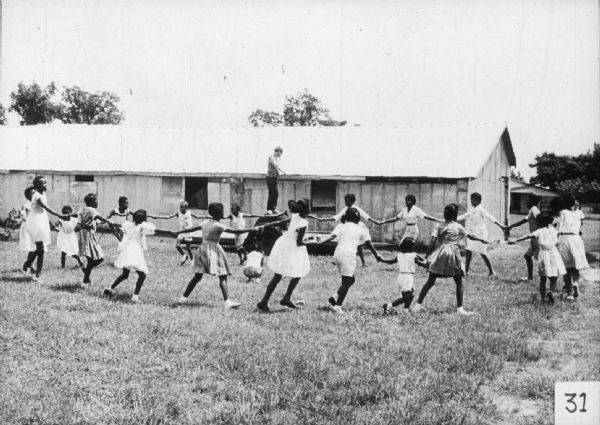 Children play a game outdoors as a part of a Freedom School activity. (Wisconsin Historical Society)