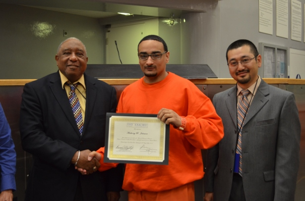 Anthony Johnson shook hands with Dr. Bernard Lafayette as he received his certificate after completing his training-of-trainers with Kazu Haga. (WNV/Carly Hoops) (L to R) Dr. Bernard Lafayette, Anthony Johnson and Kazu Haga