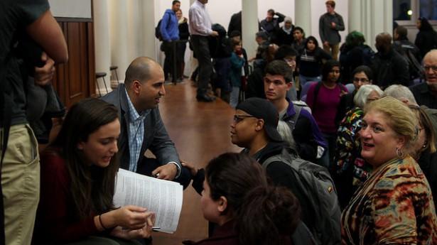 Steven Salaita speaks with students at Northwestern after an event on October 6. (Flickr/ Jeffrey Putney)