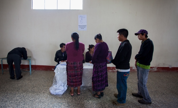 Residents of Santa Maria Chiquimula wait in line on October 26 to receive their ballot to vote on whether they would support the extractive project within their territory. (WNV/Jeff Abbott)